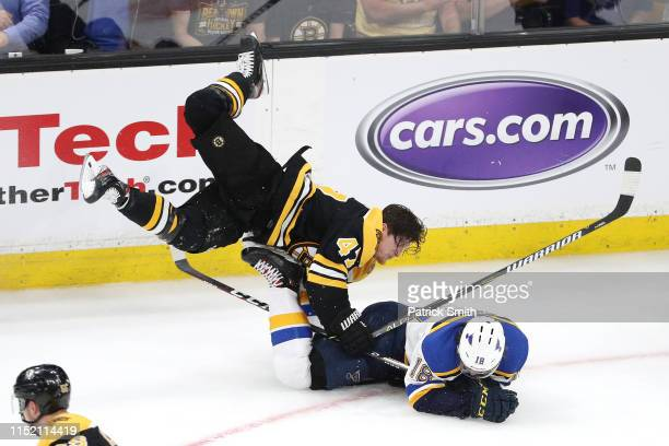 Torey Krug of the Boston Bruins checks Robert Thomas of the St Louis Blues during the third period in Game One of the 2019 NHL Stanley Cup Final at...