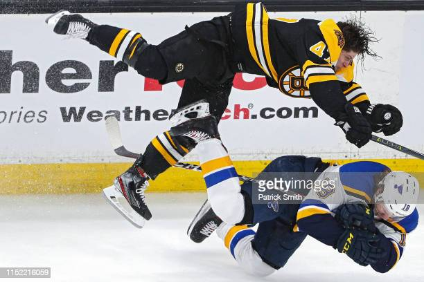 Torey Krug of the Boston Bruins checks Robert Thomas of the St. Louis Blues during the third period in Game One of the 2019 NHL Stanley Cup Final at...