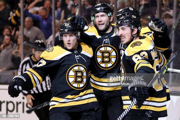 Torey Krug of the Boston Bruins David Backes and Brad Marchand celebrate with Patrice Bergeron after he scored a goal against the Toronto Maple Leafs...