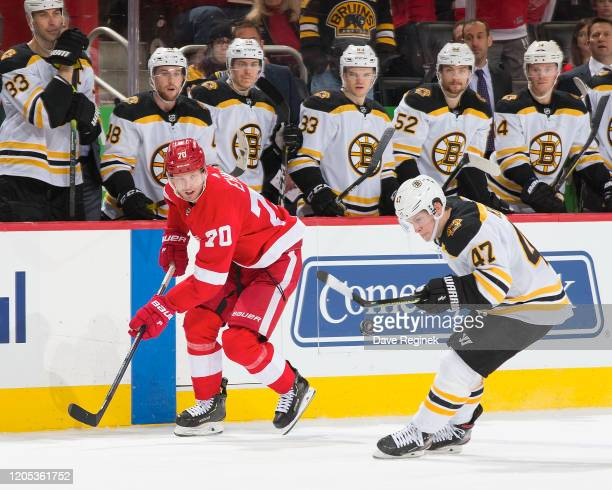 Torey Krug of the Boston Bruins knocks down a pass from Christoffer Ehn of the Detroit Red Wings during an NHL game at Little Caesars Arena on...