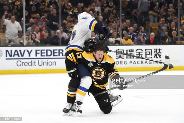 Torey Krug of the Boston Bruins mixes it up with David Perron of the St Louis Blues during the third period in Game One of the 2019 NHL Stanley Cup...