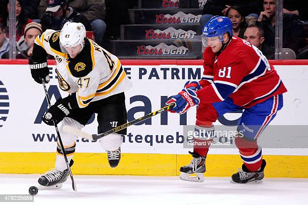 Torey Krug of the Boston Bruins stick handles the puck while being chased by Lars Eller of the Montreal Canadiens during the NHL game at the Bell...