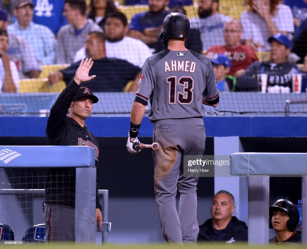 Torey Lovullo #17 of the Arizona Diamondbacks reacts to the run of Nick Ahmed #13 to trail 4-3 to the Los Angeles Dodgers during the seventh inning at Dodger Stadium on May 9, 2018 in Los Angeles, California.