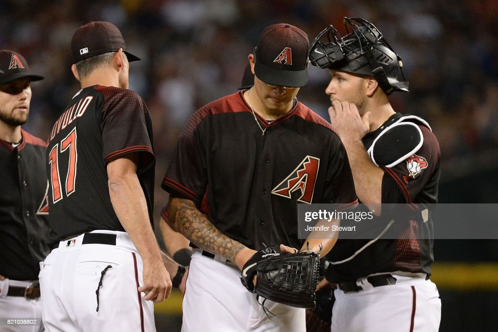 Torey Lovullo #17 of the Arizona Diamondbacks relieves Anthony Banda #50 in the sixth inning of the MLB game against the Washington Nationals at Chase Field on July 22, 2017 in Phoenix, Arizona.