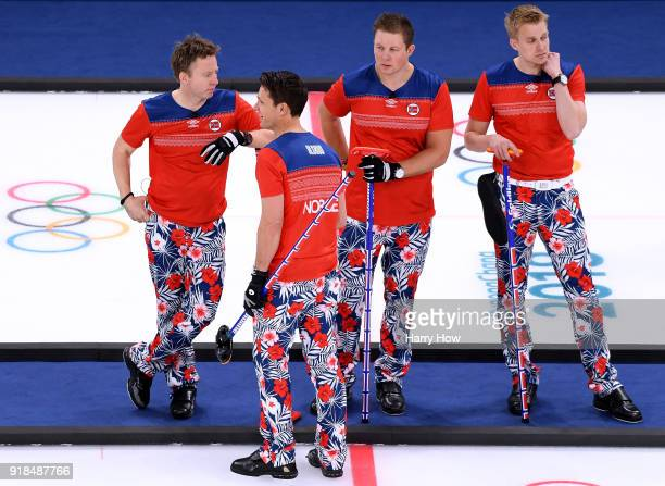 Torger Nergaard Thomas Ulsrud Christoffer Svae and Haavard Vad Petersson of Norway wait to play in a 74 loss to Canada during the Men's Curling Round...