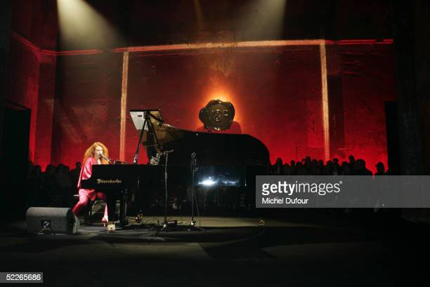 Tori Amos plays during the Viktor Rolf fashion show as part of Paris Fashion Week Ready To Wear Autumm/Winter 2006 on March 2 2005 in Paris France