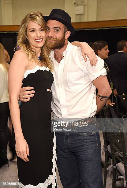 Tori Anderson and Joshua Sasse backstage before The CW Network's 2016 Upfront at New York City Center on May 19 2016 in New York City