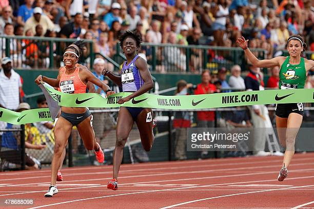 Tori Bowie crosses the finish line ahead of English Gardner and Jenna Prandini to win the Women's 100 Meter Dash Final during day two of the 2015 USA...