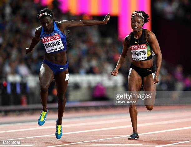 Tori Bowie of the United States crosses the finish line to win the Women's 100 Metres Final ahead of Elaine Thompson of Jamaica during day three of...
