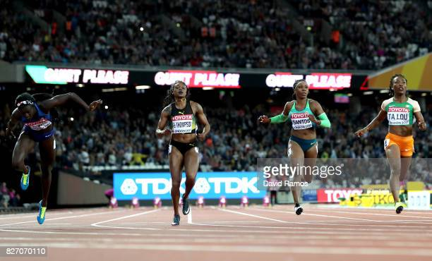 Tori Bowie of the United States crosses the finishline ahead of Marie-Josee Ta Lou of the Ivory Coast to win the Women's 100 Metres Final during day...