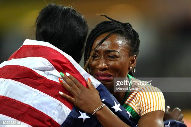 Tori Bowie of the United States, gold, celebrates with Marie-Josee Ta Lou of the Ivory Coast, silver, after the Women's 100 Metres Final during day...