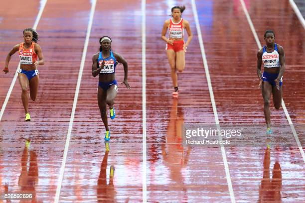 Tori Bowie of the United States leads the way from Desiree Henry of Great Britain during the womens 100m heats during day two of the 16th IAAF World...