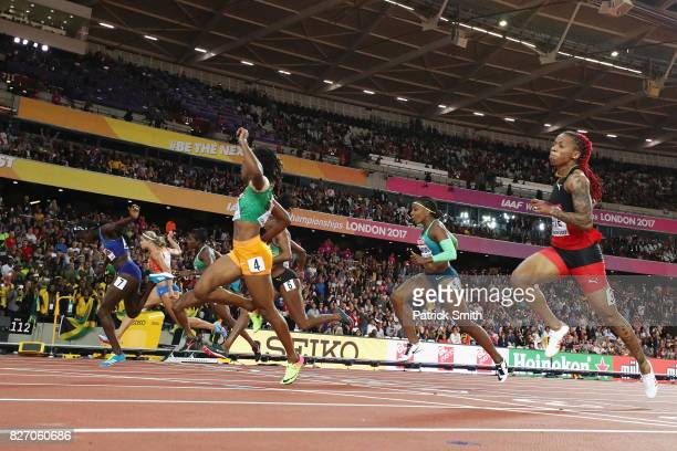 Tori Bowie of the United States races to the finishline ahead of Marie-Josee Ta Lou of the Ivory Coast and Dafne Schippers of the Netherlands to win...