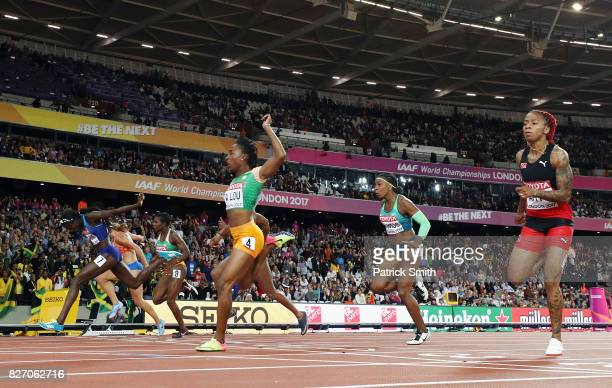 Tori Bowie of the United States races to the finishline ahead of MarieJosee Ta Lou of the Ivory Coast and Dafne Schippers of the Netherlands to win...