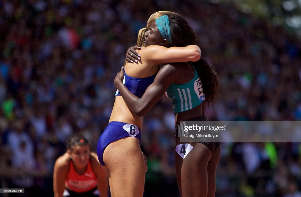 Tori Bowie of the United States, right, and Dafne Schippers of Netherlands hug after the 200 meter race at Hayward Field on May 28, 2016 in Eugene, Oregon. Bowie won the race in a time of 21.99.