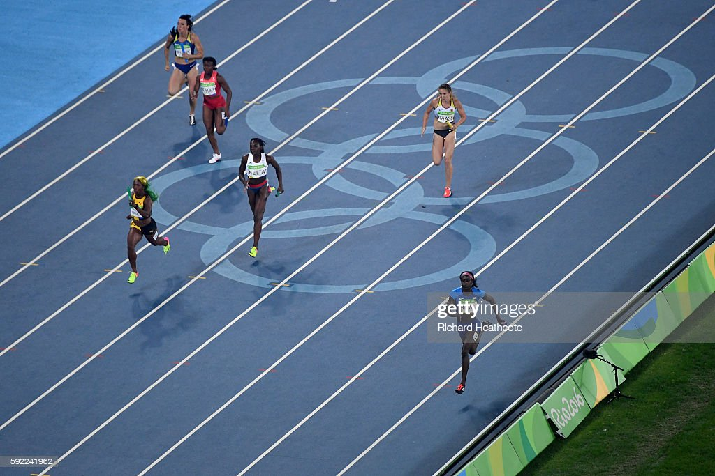 Tori Bowie of the United States, Shelly-Ann Fraser-Pryce of Jamaica and Daryll Neita of Great Britain compete in the Women's 4 x 100m Relay Final on Day 14 of the Rio 2016 Olympic Games at the Olympic Stadium on August 19, 2016 in Rio de Janeiro, Brazil.