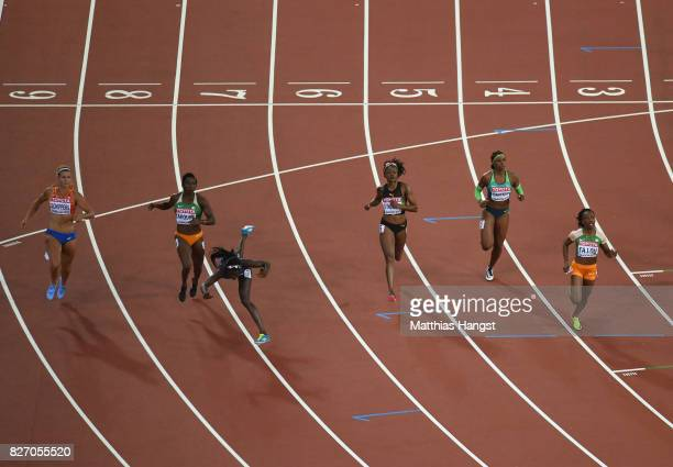 Tori Bowie of the United States tumbles accross the finishline on her way to winning gold in the Women's 100 Metres Final in front of Murielle Ahoure...