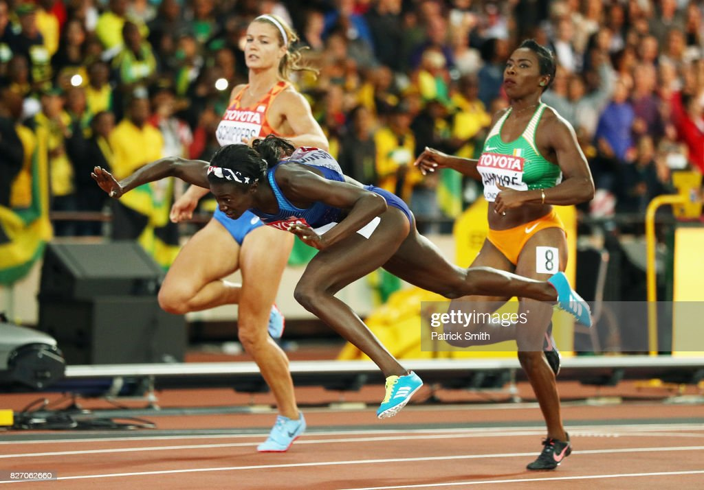 Tori Bowie of the United States tumbles accross the finishline on her way to winning gold in the Women's 100 Metres Final in front of Dafne Schippers of the Netherlands, silver, and Murielle Ahoure of the Ivory Coast during day three of the 16th IAAF World Athletics Championships London 2017 at The London Stadium on August 6, 2017 in London, United Kingdom.