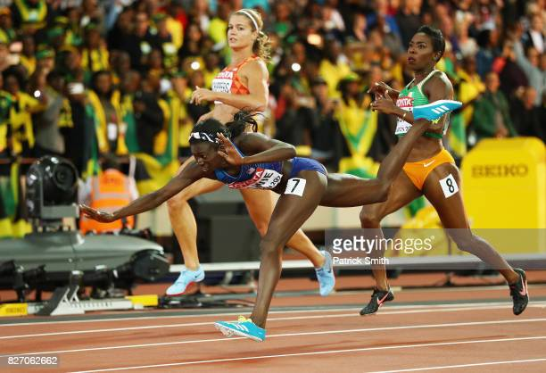 Tori Bowie of the United States tumbles accross the finishline on her way to winning gold in the Women's 100 Metres Final in front of Dafne Schippers...