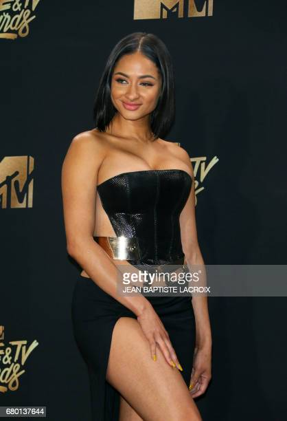 Tori Brixx poses in the press room during the 2017 MTV Movie and TV Awards at the Shrine Auditorium in Los Angeles California on May 7 2017 / AFP...