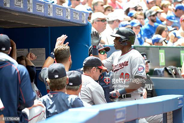 Tori Hunter of the Minnesota Twins is greeted in the dugout after hitting a solo home run during the game against the Toronto Blue Jays at the Rogers...