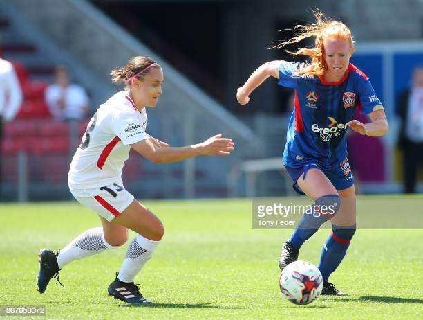 Tori Huster of the Jets and Alexandra Huynh of the Wanderers contest the ball during the round one WLeague match between the Newcastle Jets and the...