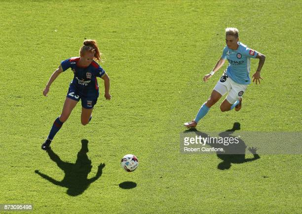 Tori Huster of the Jets is chased by Jess Fishlock of Melbourne City during the round three WLeague match between Melbourne City and the Newcastle...