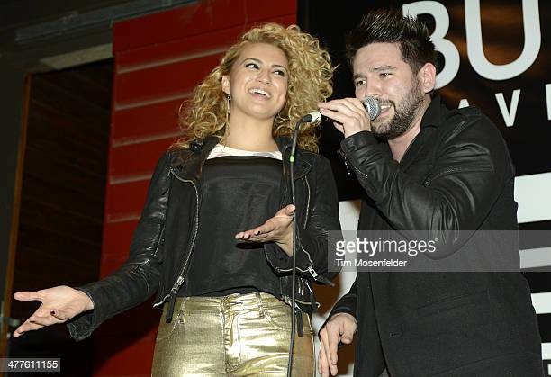 Tori Kelly and Shay Mooney of Dan Shay perform at the Scooter Braun Projects Sunday Funday Showcase at Bangers on March 9 2014 in Austin Texas
