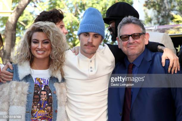 Tori Kelly Justin Bieber and Sir Lucian Grainge pose as Grainge is honored with a star on the Hollywood Walk of Fame on January 23 2020 in Hollywood...
