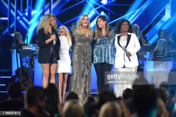 Tori Kelly Kristin Chenoweth Trisha Yearwood Hillary Scott and CeCe Winans perform during the 2019 CMA Country Christmas at Curb Event Center on...
