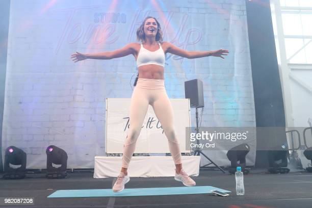 Tori Simeone leads yoga on stage at the Studio Tone It Up Live at Duggal Greenhouse on June 23 2018 in Brooklyn New York