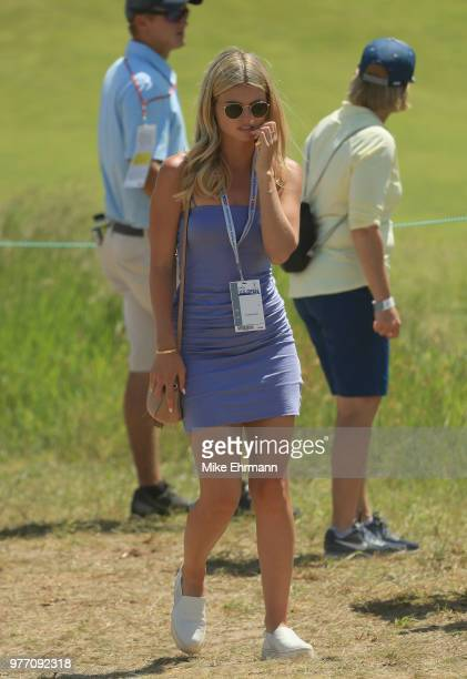 Tori Slater model and girlfriend of Daniel Berger of the United States watches play during the final round of the 2018 US Open at Shinnecock Hills...