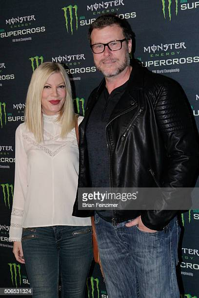 Tori Spelling and Dean McDermott arrive at The Monster Energy Supercross at Angel Stadium of Anaheim on January 23 2016 in Anaheim California