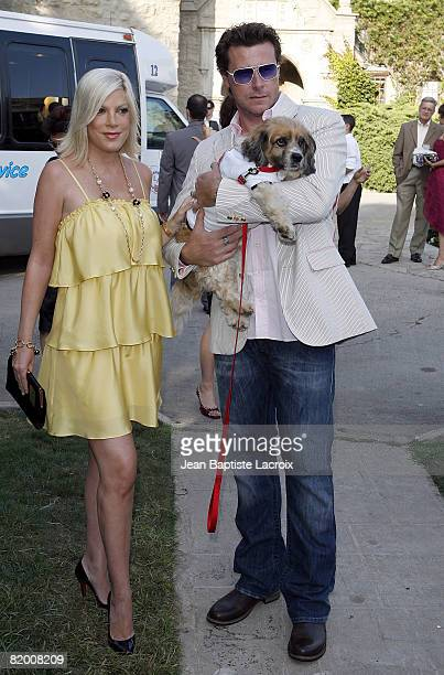 Tori Spelling and Dean McDermott arrive at the Much Love Animal Rescue Presents The Second Annual Bow Wow WOW at The Playboy Mansion on July 19 2008...
