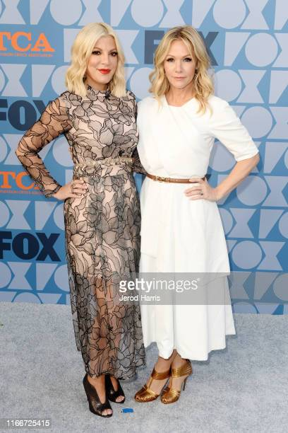 Tori Spelling and Jennie Garth arrive at FOX Summer TCA 2019 All-Star Party at Fox Studios on August 07, 2019 in Los Angeles, California.