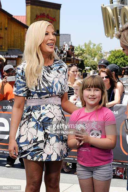 Tori Spelling and Stella Doreen McDermot visit Extra at Universal Studios Hollywood on June 16 2016 in Universal City California