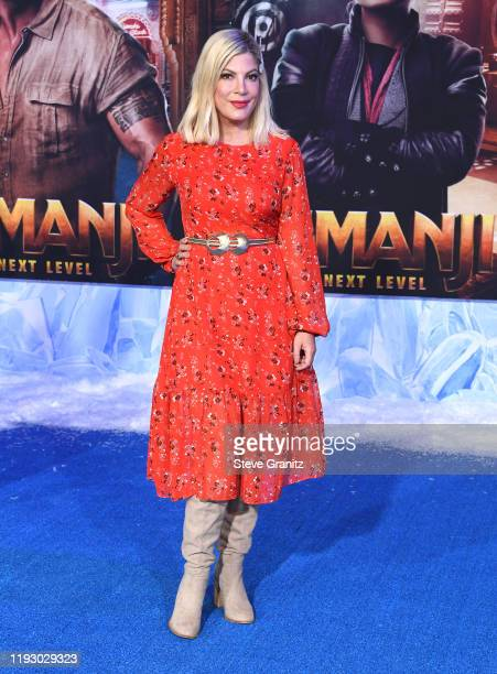 "Tori Spelling arrives at the Premiere Of Sony Pictures' ""Jumanji: The Next Level"" on December 09, 2019 in Hollywood, California."
