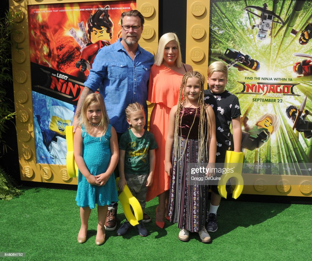 Tori Spelling, Dean McDermott and children arrive at the premiere of Warner Bros. Pictures' 'The LEGO Ninjago Movie' at Regency Village Theatre on September 16, 2017 in Westwood, California.