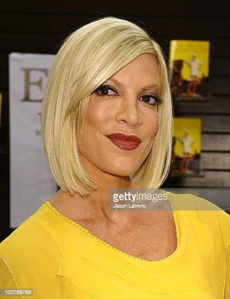 """Tori Spelling signs copies of her new book """"Uncharted TerriTORI"""" at Barnes & Noble bookstore at The Grove on June 21, 2010 in Los Angeles, California."""