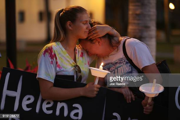 Tori Stetzer and Taylor Miller become emotional as they attend a candle light vigil at Florida Atlantic University for the 17 people killed during a...