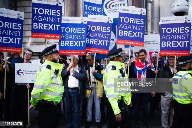 'Tories Against Brexit' demonstrators hold placards on Piccadilly during the protest A mass 'Together for the Final Say' march organised by the...