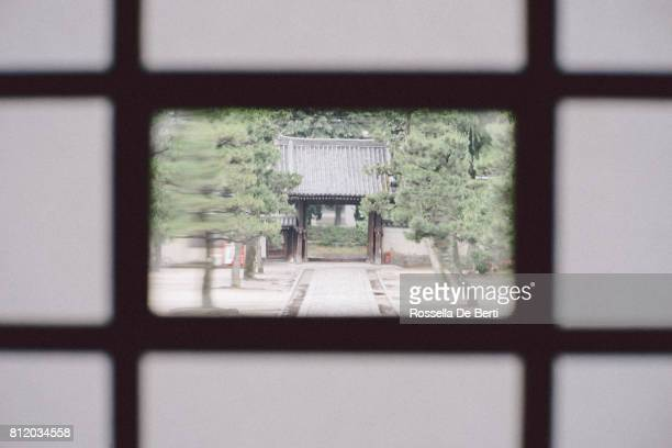 torii gate, entrance gate of a buddhist temple - man made structure stock pictures, royalty-free photos & images