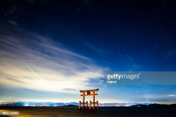 Torii gate on the lake under the stadium of stars