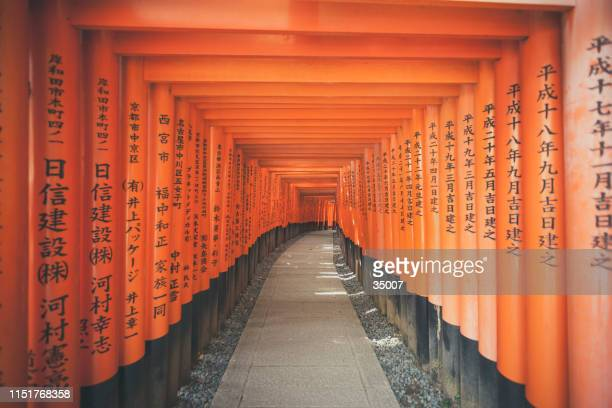 torii gates at fushimi inari shrine in kyoto, japan - shinto shrine stock pictures, royalty-free photos & images