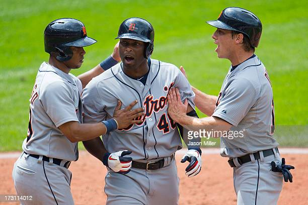 Torii Hunter celebrates after hitting a home run scoring Ramon Santiago and Andy Dirks of the Detroit Tigers to tie the game during the eighth inning...