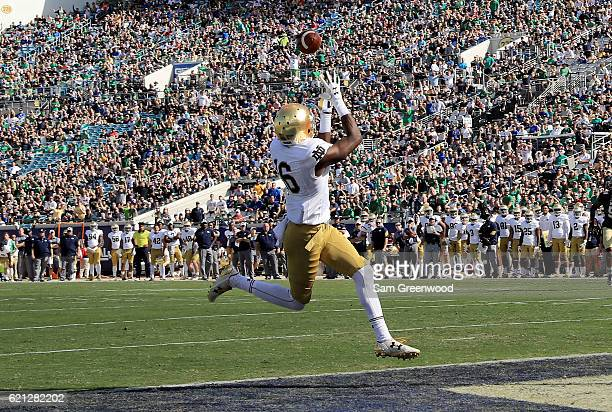 Torii Hunter Jr #16 of the Notre Dame Fighting Irish attempts a reception during the game against the Navy Midshipmen at EverBank Field on November 5...
