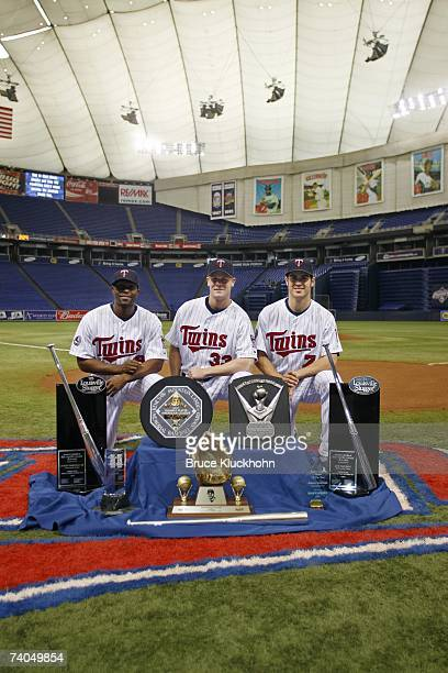 Torii Hunter Justin Morneau and Joe Mauer pose with the awards they received from the 2006 season prior to the game against the Tampa Bay Devil Rays...