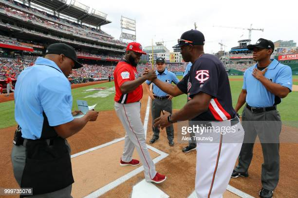 Torii Hunter of Team USA and David Ortiz of the World Team shake hands at home plate prior to the SiriusXM AllStar Futures Game at Nationals Park on...