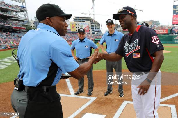 Torii Hunter of Team USA shakes hands with home plate umpire Malachi Moore prior to the SiriusXM AllStar Futures Game at Nationals Park on Sunday...