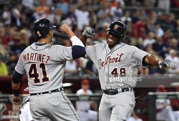 Torii Hunter of the Detroit Tigers and teammate Victor Martinez celebrate a tworun home run during the second inning against the Arizona Diamondbacks...